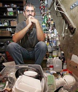 Dave Chameides with six months of trash in his basement in LA.