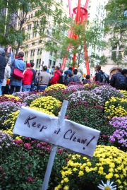 A tiny sign in one of Liberty Park's three flower gardens. October 18, 2011. Photo by Brian Gilbreath.
