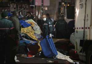 "Original photo and caption from the LA Times coverage of the settlement: ""New York sanitation workers remove debris and belongings left by protesters of Occupy Wall Street from Zuccotti Park during a nighttime raid on Nov. 15, 2011. (Carolyn Cole / Los Angeles Times / November 15, 2011)"""