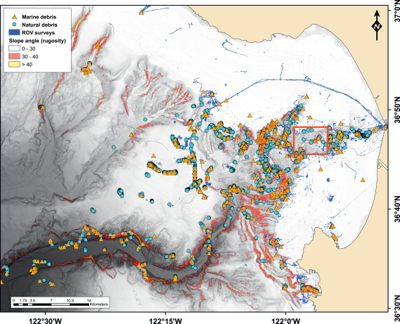 "From the article: The relationship between rugosity and debris distribution in Monterey Canyon. MBARI ROV surveys over the 22-year study period are shown in blue. The distribution of natural debris (drift kelp, wood) in Monterey Bay is indicated by the blue circles; the distribution of anthropogenic marine debris is indicated by the orange triangles. The red box outlines a ""clean"" section of the canyon."