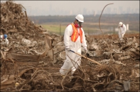 Worker combing through debris from the World Trade Center at the Fresh Kills landfill. From United States Federal Bureau of Investigation.