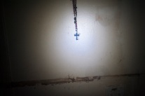"Original caption: ""A cross hanging in the room of Samuel Montalvo, with the high-water line on the wall, November 1st."" Photograph by Adrian Fussell/Reportage by Getty Images. Hurricane Sandy."
