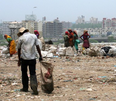Waste pickers collecting waste in Delhi landfill. Photo by Mackenzie Berg. Image not for republication.