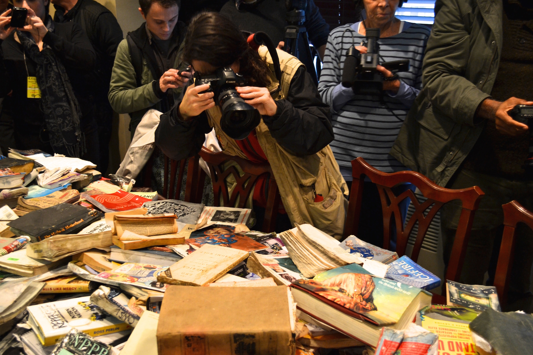 the dregs of the library trashing the occupy wall street library press photographing damaged books at the conference announcing a lawsuit against the city of new york