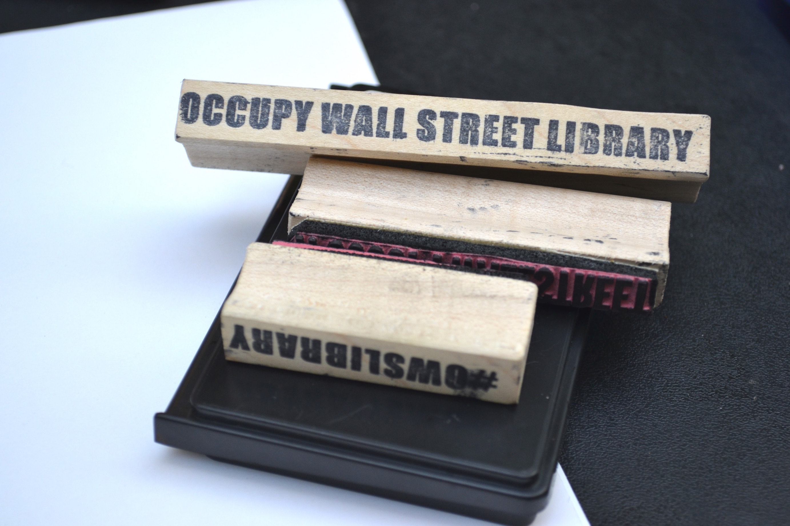 the dregs of the library trashing the occupy wall street library image 4 stamps for labeling incoming books photo m reagan