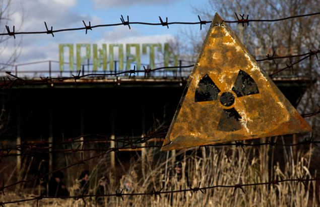 A radioactive sign hangs on barbed wire outside a café in Pripyat, Chernobyl.